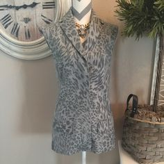"TopShop tunic length vest Beautiful gray leopard print vest by TopShop. Measures 27"" from shoulder to hem. Wool & fully lined in silk. Hidden button placket all the way down. 10"" slit in back at bottom. Fits really cute! Never worn & new condition. Topshop Jackets & Coats Vests"