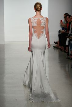 Brides.com: 25 New Wedding Dresses with Statement Backs. Wedding dress by Kenneth Pool  See more wedding dresses from Kenneth Pool's Spring 2015 collection.