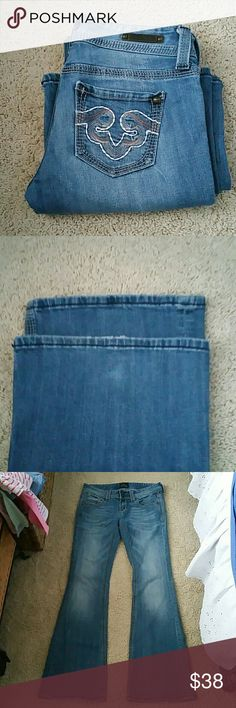 Rerock Jeans for Express Beautiful pocket designs.. Pic 1 2 tiny spots at the bottom right leg pic 3, barely noticeable just wanted to point them out.. :) Size us 4 Euro 27 Flare leg 98% cotton  2% spandex  Inseam is 32 1/2 inches  Rise is 7 1/2 inches rerock Jeans for Express  Jeans Flare & Wide Leg