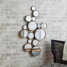 fifteen circles mirror by decorative mirrors online | notonthehighstreet.com because every living room needs reflection of light and movement,a little vanity in the living room is so 'me to a tee'
