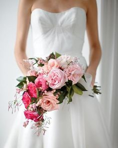 Jasmine, Roses, Camellia leaves, and Snowberries in a Cascade Bouquets <3