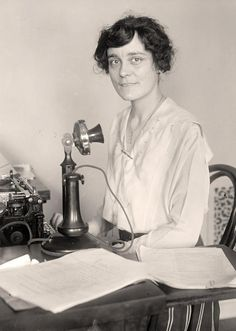 You are looking at an old photo of Secretary Typing. It was created in 1918 by Harris & Ewing.