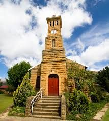 Photo about A small sandstone church in the town of Clarens, South Africa. Image of door, blue, clouds - 22529818 Heavenly Places, Free State, Church Building, Place Of Worship, Live, South Africa, Places To Go, Royalty Free Stock Photos, Cathedrals