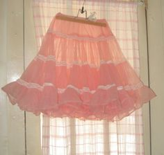 My sister had so many pastel crinolines! Pink, aqua, white, blue, yellow and green~!