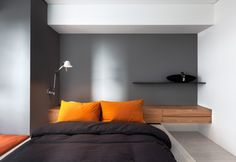 Interior, Uplifting Shades Displayed On The Gray Wall Behind The Orange And Black Bed With Stylish Patented Shelves And Bedside Idea ~ Lovely Small Apartment Interior Featuring Stylish and Minimalist Idea