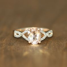 Infinity Diamond Morganite Engagement Ring 14k Rose Gold Pink Morganite Wedding Ring Oval Morganite Solitaire Ring, Size 7 (Resizable) by LuxCrown on Etsy https://www.etsy.com/listing/201163176/infinity-diamond-morganite-engagement
