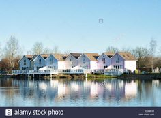 Clapperboard style houses along a lake at the watermark club, Cotswold Water Park, Gloucestershire, England Stock Photo