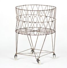 would love to find a vintage one of these french laundry baskets. So pretty.