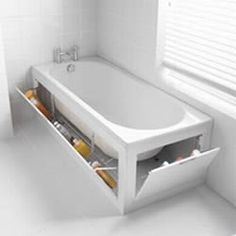 Stowaway's bath panel storage system. The opening panels on the sides of the bath create a discreet storage space.