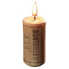 Create a bistro-chic display with this charming beeswax candle, featuring a wine cork-inspired design.  Product: Set of 8 candle...