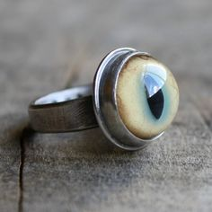 Hey, I found this really awesome Etsy listing at https://www.etsy.com/listing/62864492/bobcat-eyeball-ring