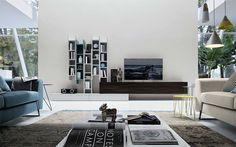Soggiorno by FEBAL CASA. Gli elementi a giorno permettono la creazione di un modulo libreria anche in pareti di dimensioni contenute completando le basi con disegni di estrema flessibilità.