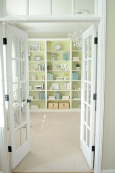 Custom bookshelf made with IKEA shelves - I love the green background and blue accessories!