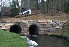 Skyline stone used to reconstruct culvert and repair the eroding stream bank.