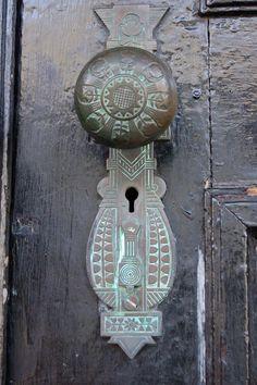 antique door knob complete with green tarnish.