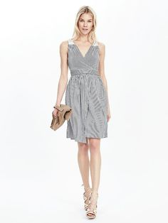 Discover the perfect day to night dress with our flattering fit and flare silhouette dress. This cotton blend striped retro inspired frock has a touch of old school glam that will keep your look effortlessly chic. Pair this piece with heeled sandals or embellished flats and a cardigan | Banana Republic