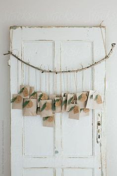Natural advent calendar on a rustic white door