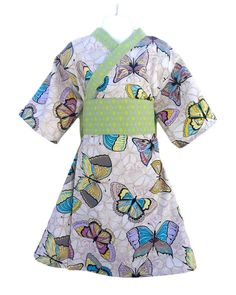 This modern style kimono Yukata is a comfortable and easy-to-wear dress for girls. It is made with 100% cotton, so its machine washable, and durable. The dress snaps on the inside and out to keep the kimono closed. It is pulled together with a remove-able obi belt, which can be tied in the front or in the back into a bow. This listing is for the LINEN BUTTERFLY, which large butterflies in blues and purples on a cotton linen fabric