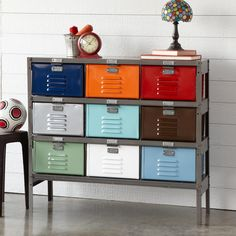 """VINTAGE 9-DRAWER LOCKER -- Steel lockers salvaged from earlier lifetimes reinvigorate modern storage, refurbished with bright powder-coating and a sleek gray frame. Each vented 12""""W x 12""""D x 7""""H drawer is a different color—ideal for children, the family mudroom or your favorite crafts projects. Made in USA. 42""""W x 13""""D x 36""""H."""