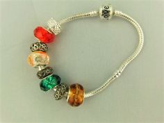 Topaz Green Clear Red European Lampwork Bead Bracelet with Silver Plated Spacers £10.00