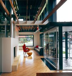 The renovation opens the façade to main street and the river. Workplace Design: Gensler