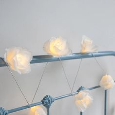 Our white fabric fairy lights are as beautiful as the rose they're named after. With a dainty clear cable, they're perfect for weaving around bed frames  | Lights4fun.co.uk Hipster Room Decor, Warm White, White Bed Frame, Fairy Lights, Hipster Bedroom Decor, Fairy Lights Bedroom, Fabric Roses, Led, Battery Operated Lights