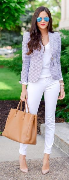 All-white ensemble with a light blue-and-white striped blazer and camel bag.