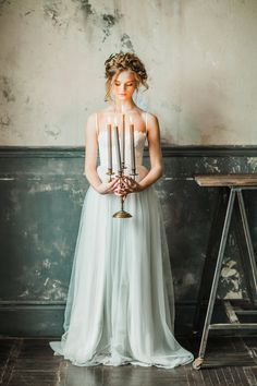Bride with candelabra ⎪ Antonova Kseniya Photography ⎪ see more on: http://burnettsboards.com/2015/04/spring-nature-bridal-portraits/