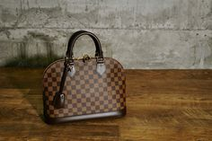 240081889d37 Win this Louis Vuitton Damier Canvas Alma PM Bag - Yoogi s Closet