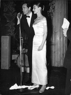 Audrey and Mel photographed in Hassler Hotel, Rome, during party held in honor of actors who filmed the movie War an Peace,1955