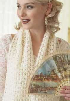 Wide textured scarf with popcorn stitch detail. Works as a wrap or as a cozy scarf. Shown in Patons Lace.