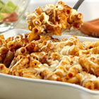 Baked Ziti Recipe   Ingredients   1 (26 ounce) jar Prego® Traditional Italian Sauce   1 1/2 cups shredded mozzarella cheese   5 cups hot cooked tube-shaped pasta (ziti)   1/4 cup grated Parmesan cheese           Directions  1. Mix pasta sauce, 1 cup mozzarella cheese and ziti. Spoon into 2-quart shallow baking dish. Sprinkle with remaining mozzarella cheese and Parmesan cheese.   2. Bake at 350 degrees F for 30 minutes or until hot.