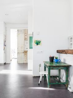 A vintage/rustic desk space for a kid - love that it's not in the kids room but part of a larger living space.