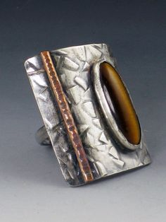 Hey, I found this really awesome Etsy listing at https://www.etsy.com/listing/244104311/tiger-eye-shield-ring-mixed-metal-ring