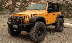 "Suspension: 3.5"" DualSport SC w/ 4.5"" Bump Stop SpacersWheel/Tire: AEV Black Pintlers / 37/12.50/17 IROK Super SwamperLocation: Southern Utah Desert  Download this image"