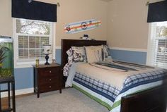 Traditional Kids Bedroom with Hardwood floors, Chair rail