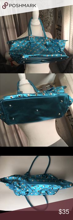 St. Tropez Essentials Leather Metallic Blu Handbag St. Tropez Essentials - Leather - Gorgeous - Metallic Blue - Silver Studded - Roomy Double Handles - Footed Flat Bottom - Top zipper - lined inside with Large zipper compartment and small open compartment - NO STAINS - Wonderful Condition - Fast Shipping St. Tropez Essentials Bags
