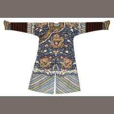 A blue ground kesi-woven silk dragon robe Late Qing dynasty Its nine dragons woven in fine gilt-wrapped threads while the cranes and bats flying amid the surrounding clouds, other auspicious emblems and the wide lishui border are worked in white and brightly colored threads; the black ground collar band and cuffs woven en suite.