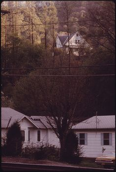 Typical Shot of Miners' Homes by the Railroad Tracks While the Supervisor's House Is Up the Hill. Boone County, WV.