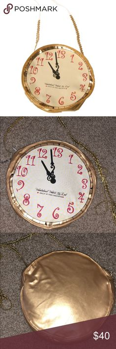 Alice In Wonderland Gold Clock Purse❤️🕐 Brand new never been used! Also have matching ears listed on my closet would go great together for a trip to Disney!❤️🌹👑  Gold purse w/ matching strap Clock printing Zips open and close Disney Bags