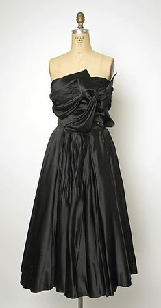 Designer: Jacques Fath (French, 1912–1954) Design House: House of Jacques Fath (French, founded 1937) Department Store: I. Magnin & Co. (American, founded 1876) Date: probably 1943–47 Culture: French Medium: silk Dimensions: Length: 39 in. (99.1 cm) Credit Line: Gift of Liso Starrett, 1988