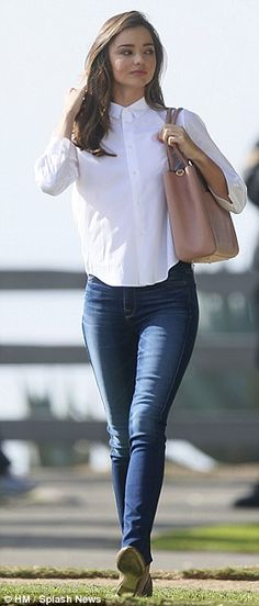 Quick change! Soon she was in a completely different outfit, donning a crisp white shirt, blue jeans and another pair of ballet flats