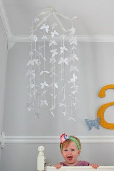 She may be too old for a mobile, but this would still look really cute hanging in the corner of her room!