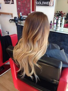 Long ombré hair from warm brown to super light blonde hair