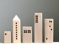 "5 wooden houses, ridiculously overpriced at $55.00 (tallest is 3"")"