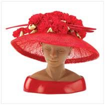 "Dressed in red so bold and bright, this lovely lady looks just right! Created by famed designer Harriet Rosebud, this portrait bust brightens your home with a little sultry Southern charm. Custom hat box and storyline booklet included. Weight 0.6 lb. Sinamay cloth and vinyl mannequin. 5"" x 5 1/4"" x 4 3/4"" high.	  	    Item:  13134    Price: $19.95  Grand-Opening Price: $11.97  (40% Off)"