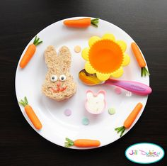 bunny    from meet the dubiens blog      Chicken sandwich cut into bunny using bunny cookie cutter. Icing eyes, heart sprinkle nose and gel icing mouth. Flower silicone muffin liner with orange jello. Carrots around the plate are made using baby carrots and cutting stems out of cucumber. These were so cute! Little bunny cup with ranch dressing for dipping. Sprinkles on plate for decoration.    Everyone is always asking me where I get my supplies, so I'm adding some links for anyone interested.