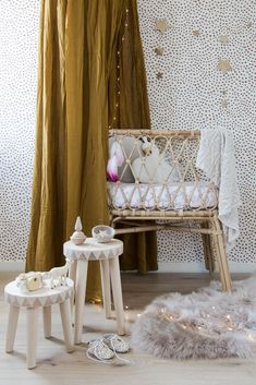 Gorgeous cane bassinet, spot printed wallpaper and timber accessories with gold accents and grey textiles.