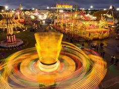 Photographic Print: Spinning Carnival Rides at the Kansas State Fair by Joel Sartore : 16x12in
