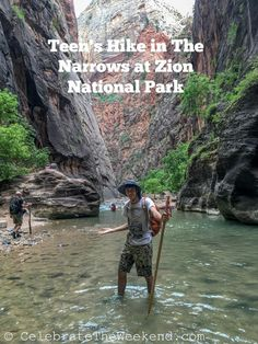 Teen is hiking in The Narrows trail in  Zion National Park in Utah on a family trip